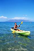 "diver returns from ""adventure dive"" carrying dive gear in back of kayak, 4 Seasons Resort, Wailea, Maui, Hawaii  ( Pacific ) MR 294"