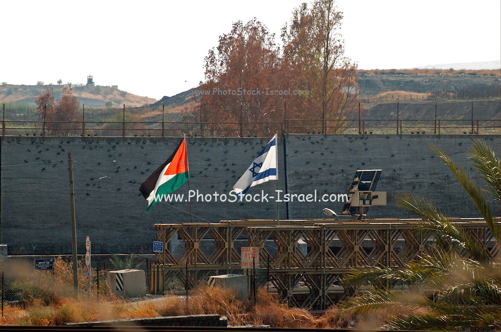 Israel, Galilee The Israeli and Jordanian flags flying over a joint tourism project in the Jordan Valley