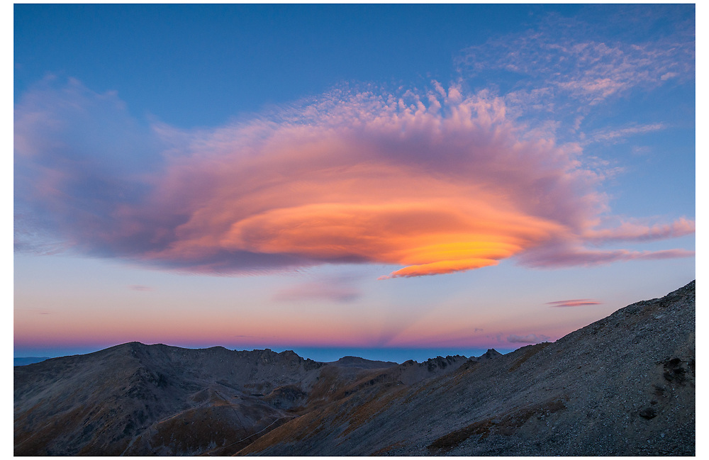 Lenticular clouds above The Remarkables, Queenstown, Otago.