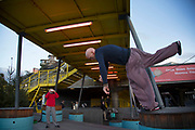 Parkour practitioners underneath the yellow gantry on the Southbank, London, United Kingdom. The South Bank is a significant arts and entertainment district, and home to an endless list of activities for Londoners, visitors and tourists alike.