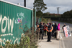 Harefield, UK. 12th September, 2020. Environmental activists acting in solidarity with HS2 Rebellion block a gate providing access to a site for the HS2 high-speed rail link. Anti-HS2 activists continue to try to prevent or delay works on the controversial £106bn HS2 high-speed rail link in the Colne Valley where thousands of trees have already been felled.