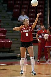 25 September 2004   Redbird Kelly Rikli serves.      Illinois State University Redbirds V University of Northern Iowa Panthers Volleyball.  Redbird Arena, Illinois State University, Normal IL
