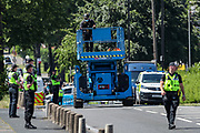 Birmingham, United Kingdom, June 15, 2021: A member of Protestor Removal Police Unit is seen driving a cherry picker outside Arconic site factory in Birmingham on Tuesday, June 15, 2021. (VX Photo/ Vudi Xhymshiti)