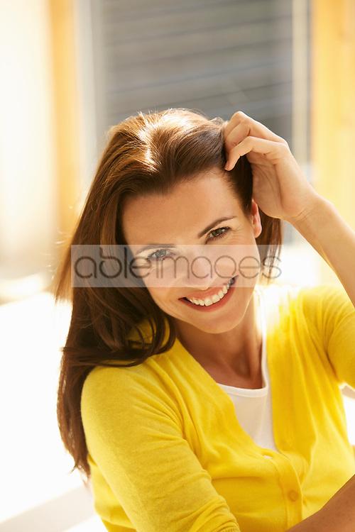 Smiling Woman Touching her Hair