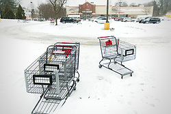 Shopping carts are left stranded in a snowbank at a grocery store parking lot as the region braces for the 'Bomb Cyclone' winter storm Grayson, on January 4, 2018, in Philadelphia, PA