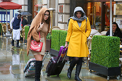 © Licensed to London News Pictures. 06/03/2019. London, UK. Women shelter from the rain beneath under scarf and a jacket as it starts raining in the capital. Photo credit: Dinendra Haria/LNP