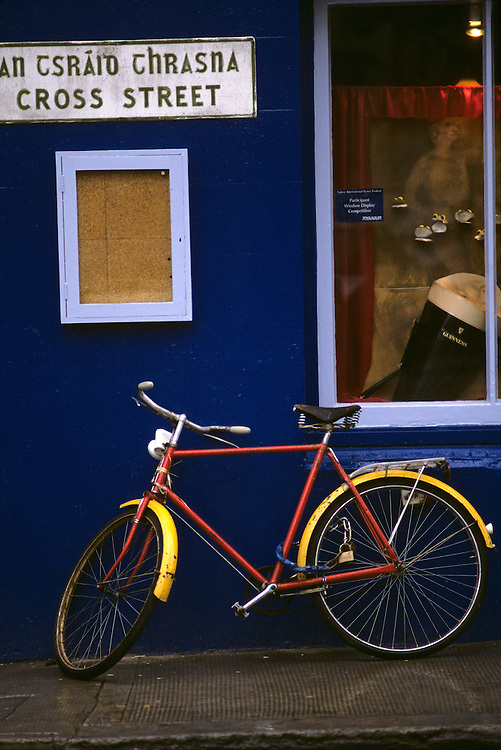 Ireland, County Galway, Galway, Bicycle leans against wall of pub on autumn afternoon