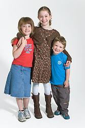 Three children smiling,