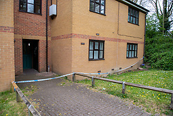 © Licensed to London News Pictures. 03/05/2021. Reading, UK. Police tape across a rear entrance and around a flat at Belford Court on Luad Close following the death of a woman on Friday 30/04/2021. Thames Valley Police were called to an address on Laud Close, Reading at approximatly 16:30 BST after reports that a 34-year-old woman had died. The death was initially treated as unexplained while officers worked to establish the exact circumstances, but following a post mortem which took place on Sunday 02/05/2021 and gave the cause of death as a blunt force head injury, a murder investigation was formally launched. Photo credit: Peter Manning/LNP