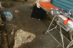 A blood stained T-shirt is seen at the scene of a suicide bomb attack in Tel Aviv, Israel, Nov. 1, 2004. Three people were killed and dozens were wounded when Palestinian Aamer Alfar, 16, blew himself up in a crowded open-air food market in the heart of Israel's commercial capital. He was from the Askar refugee camp near the northern West Bank city of Nablus.