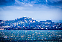 Arthur's Seat, Salisbury Crags and skyline, with the River Forth coastline, as seen from the A921 near Burntisland, Fife.