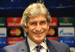 Manchester City Manager, Manuel Pellegrini smiles as he speaks at the press conference ahead of his sides match against Barcelona in the Champions League - Photo mandatory by-line: Dougie Allward/JMP - Mobile: 07966 386802 - 17/03/2015 - SPORT - Football - Barcelona - W Barcelona Hotel - Manchester City Press Conference - Round of 16 - Second Leg