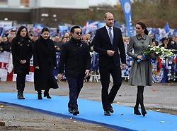 The Duke and Duchess of Cambridge, accompanied by the family of Leicester City owner Vichai Srivaddhanaprabha, lay flowers at the tribute site near to Leicester City Football ClubÕs King Power Stadium, during a visit to Leicester to pay tribute to those who were killed in the helicopter crash last month.