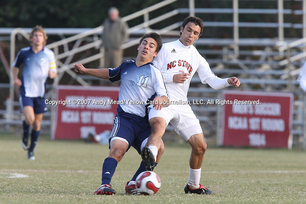 10 November 2007: Duke's Spencer Wadsworth (11) is challenged by NC State's Ernesto DiLaudo (ARG) (7). The Duke University Blue Devils defeated the North Carolina State University Wolfpack 2-0 at Method Road Soccer Stadium in Raleigh, North Carolina in an Atlantic Coast Conference NCAA Division I Men's Soccer game.