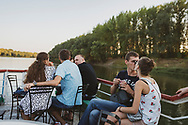 Passengers aboard a Dniester River cruise boat in Tiraspol, Transnistria.<br /><br />(September 10, 2016)