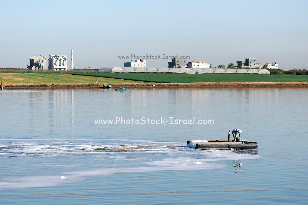 Sewerage treatment facility. The treated water is then used for irrigation and agricultural use. Photographed near Hadera, Israel <br /> final stage the clear water is aerated and exposed to oxygen to allow biological activities