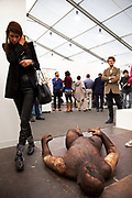 Lost and Found by Huma Mulji. Visitors and exhibitors at the many galleries exhibiting at the Frieze Art Fair 2012. This art fair is for work at the high end of international contemporary art with many well known artists on show from many of the world's most reknowned dealers.