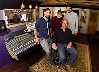 Ryan Ordway, Franz Haase, Cameron McGonagle and Alan Loudon (seated) in the recording studio for the Recording Coop in Gilford Wednesday morning.  (Karen Bobotas/for the Laconia Daily Sun)