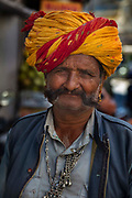 Turbaned man in traditional Rajasthani costume on the 19th January 2018  in the city of Udaipur, India.  The man flaunts his moustache, which goes well with the Rajputana spirit that symbolizes the valor and glory of Rajasthan.