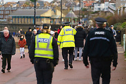 Portobello, Scotland, UK. 10 January 2020. Despite a national lockdown currently enforced in Scotland, Portobello promenade and beach was busy with large numbers of people spending Sunday afternoon there. Several police patrols were evident mostly keeping low key but officers spoke to cafe owners to urge them to keep correct social distancing between customers.  Iain Masterton/Alamy Live News