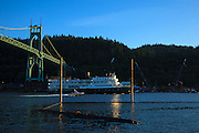 USA, Oregon, Portland, Cathedral Park, two boats on the Willamette River, passing under the St. John's Bridge.