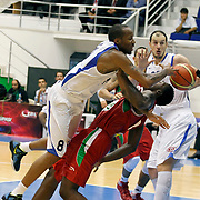 Anadolu Efes's Terence KINSEY (L) during their Turkey Cup Qualifying basketball second match Anadolu Efes between Pinar Karsiyaka at Aliaga Arena in Izmir, Turkey, Monday, October 10, 2011. Photo by TURKPIX