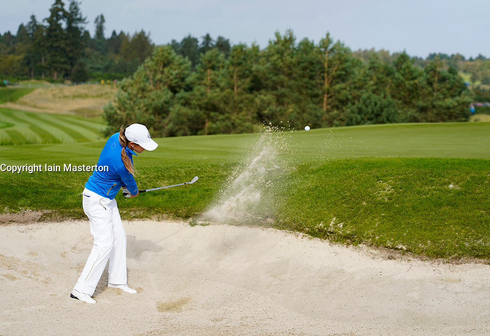 Auchterarder, Scotland, UK. 15 September 2019. Sunday Singles matches on final day  at 2019 Solheim Cup on Centenary Course at Gleneagles. Pictured; Azahara Munoz of Team Europe  plays out of bunker to 8th green.  Iain Masterton/Alamy Live News