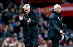 Manchester United manager Jose Mourinho (left) applauds during the Premier League match at Old Trafford, Manchester.