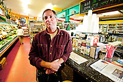 Kyle Ater, owner of the Homegrown Market, Orcas Island, WA.  Colton Harris-Moore broke in to the market, and drew his 'bare' foot prints on the floor.