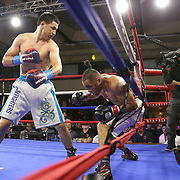 Zhankizh Turatov of Almaty, Kazakhstan (L) fights Gustavo Garibay of Mexico during a Nelsons Promotions boxing match at the Boca Raton Resort  and Club on Friday, May 26, 2017 in Boca Raton, Florida.  (Alex Menendez via AP)