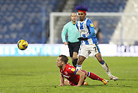 Huddersfield Town's Juninho Bacuna lifts the ball over the challenge from Reading's Michael Morrison<br /> <br /> Photographer Rich Linley/CameraSport<br /> <br /> The EFL Sky Bet Championship - Saturday 2nd January 2021 - Huddersfield Town v Reading - The John Smith's Stadium - Huddersfield<br /> <br /> World Copyright © 2020 CameraSport. All rights reserved. 43 Linden Ave. Countesthorpe. Leicester. England. LE8 5PG - Tel: +44 (0) 116 277 4147 - admin@camerasport.com - www.camerasport.com