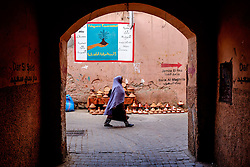 A Moroccan woman in traditional dress walks  through the Medina in Marrakech, Morocco, North Africa<br /> <br /> <br /> (c) Andrew Wilson | Edinburgh Elite media