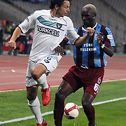Trabzonspor's Ibrahima YATTARA (R) and Denizlispor's Ahmet B SOLAKEL (L) during their Turkish superleague soccer match Trabzonspor between Denizlispor at the Avni Aker Stadium in Trabzon Turkey on Monday, 10 May 2010. Photo by TURKPIX