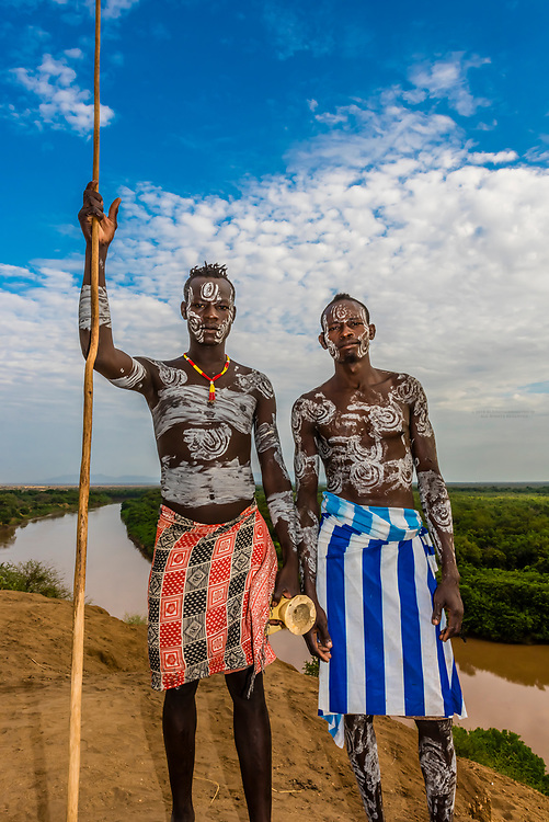 Kara tribe men near their village, with the Omo River behind, Dus, Omo Valley, Ethiopia.