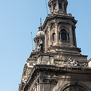 Spires of the Metropolitan Cathedral of Santiago (Catedral Metropolitana de Santiago) in the heart of Santiago, Chile, facing Plaza de Armas. The original cathedral was constructed during the period 1748 to 1800 (with subsequent alterations) of a neoclassical design.
