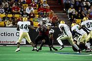 4/12/2007 - Leuma Pua'auli tries to make a hole in the Frisco Thunder Defense as the Alaska Wild would drop their home opener 33-46 to the Frisco Thunder in the first professional football game in Alaska.