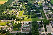 Nederland, Noordoostpolder, Nagele, 30-06-2011; dorp in de Noordoostpolder, ontworpen door architecten van De Acht en Opbouw, gekenmerkt door modernistische architectuur en stedenbouw. Scheiding van functies (verkeer, wonen, werken), strokenbouw. .Bij het de ruimtelijke inrichting van de polder is gebruikt gemaakt van de centrale-plaatsentheorie  (Christallermodel), een centrale stad (Emmeloord) met satelietdorpen als bijvoorbeeld Nagele. .Village in the northeast polder, designed by architects of The Eight and Opbouw, characterized by modernist architecture and urbanism. Segregation of functions (traffic, housing, employment), consistent construction..The spatial layout of the polder is based used the central-place theory (Christaller model), a central city (Emmeloord) with satellite towns such as Nagele..luchtfoto (toeslag), aerial photo (additional fee required).copyright foto/photo Siebe Swart