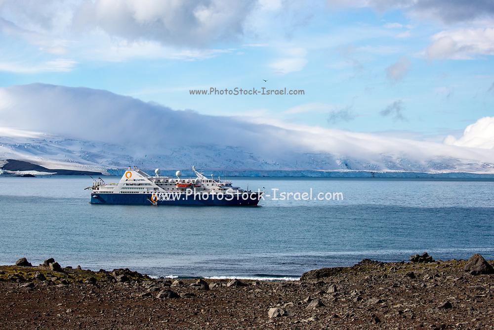 Antarctic passenger cruise ship off the icy shores of Antarctica (Ocean Diamond Quark Expeditions)