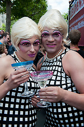 Two men dressed as women posing at the Christopher Street Day Parade in Berlin Germany 2011