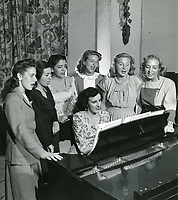 1940 Ladies gather to sing at the Hollywood Studio Club on Lodi Pl.