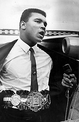 Oct. 28, 1964 - Florida, U.S. - October 28, 1964: Muhammad Ali shows off his title belt. (Credit Image: © The Palm Beach Post via ZUMA Wire)