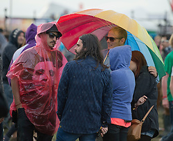 © London News Pictures. 25/08/2012. Reading, UK. Rain soaked revellers on  day two of Reading Festival 2012 in Reading, Berkshire, UK on August 25, 2012. The three day event which attracts over 80,000 music fans headlines The Cure, Kasabian and The Foo Fighters Photo credit : Ben Cawthra/LNP