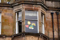 Glasgow, Scotland, UK. 3 April, 2020. Images from the south side of Glasgow at the end of the second week of Coronavirus lockdown. Pictured; hand drawn rainbows and messages in windows of flat in Govanhill. Iain Masterton/Alamy Live News