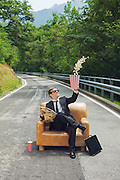 scene of businessman in break on his chair with popcorn on the street