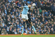 30 Nicolás Otamendi for Manchester City challenges r24Rotherham United forward Michael Smith (24) during the The FA Cup 3rd round match between Manchester City and Rotherham United at the Etihad Stadium, Manchester, England on 6 January 2019.