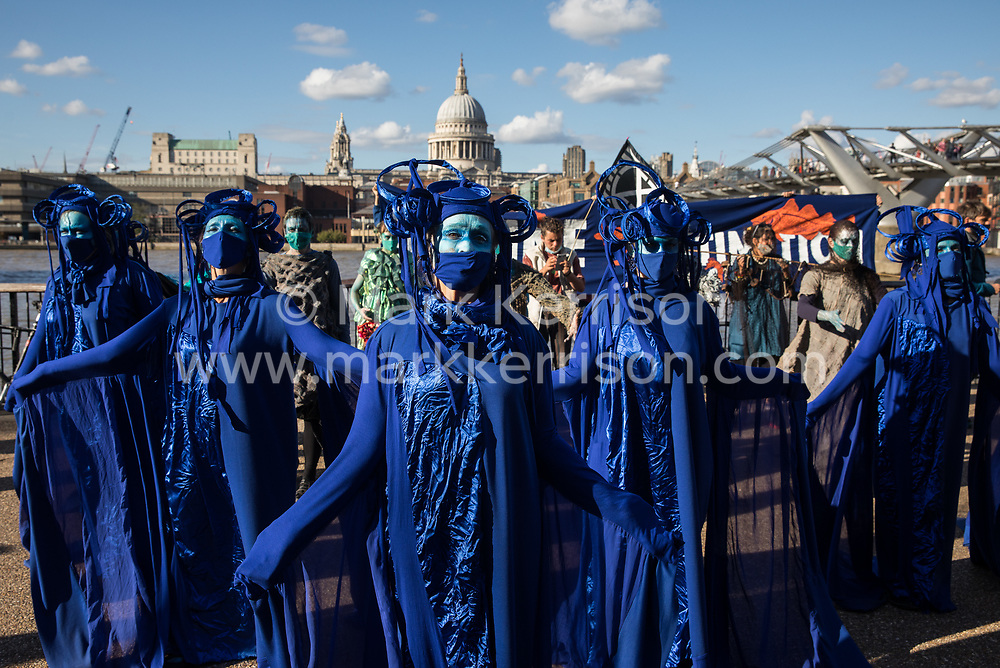 The blue rebels join fellow climate activists from the Ocean Rebellion and Extinction Rebellion on the South Bank during a colourful Marine Extinction March on 6 September 2020 in London, United Kingdom. The activists, who are attending a series of September Rebellion protests around the UK, are demanding environmental protections for the oceans and calling for an end to global governmental inaction to save the seas.