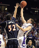 Kansas State guard Mark Frederick (R) drives to the basket against pressure from Cal State's Manny Montano (L) during the second half at Bramlage Coliseum in Manhattan, Kansas, November 30, 2005.  K-State beat Titans of Cal State Fullerton 84-59.