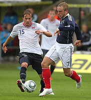 Fotball<br /> Skottland v Norge<br /> Foto: Colorsport/Digitalsport<br /> NORWAY ONLY<br /> <br /> Scotland vs Norway U21<br /> International Challenge Match, New St Mirren Park, Paisley.<br /> <br /> Jonathon Russell of Scotland Competes with Anders Konradsen of Norway <br /> <br /> 10th August 2011
