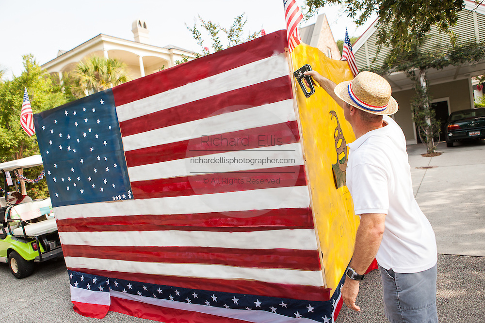 A man puts the finishing touches on his decorated golf cart during the annual I'On Community Independence Day Parade on July 4, 2012 in Mt Pleasant, South Carolina.