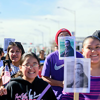 011915  Adron Gardner/Independent<br /> <br /> Marchers carry posters of Dr. Martin Luther King Jr. during the Martin Luther King Day march on Historic Highway 66 in Gallup Monday